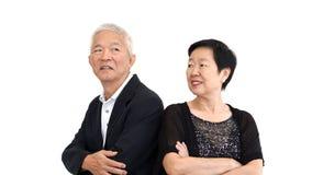 Asiatisk hög partner i formell dress Förälskelselivfamiljeföretag Royaltyfri Fotografi