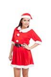 Asiatisk julflicka med Santa Claus kläder Royaltyfria Bilder