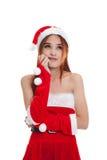 Asiatisk julflicka med Santa Claus kläder Arkivfoton