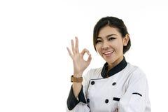 Asiatisk kock för ung kvinna på vit bakgrund Arkivfoto