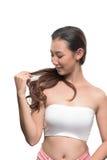 Asiatisk kvinna på vit bakgrund Royaltyfria Foton