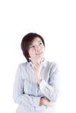 Asiatisk kvinna som tänker av något Royaltyfria Foton
