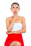 Asiatisk kvinna som tänker vara eftertänksamt Royaltyfri Bild