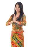 Asiatisk kvinnahälsning för Southeast arkivbild
