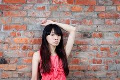Asiatisk kvinnlig som ser ledsen Arkivbild