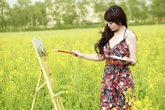 asiatisk kvinnligmålare Arkivbild