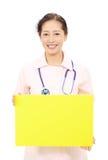 Asiatisk kvinnligsjuksköterska Fotografering för Bildbyråer