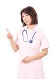 Asiatisk kvinnligsjuksköterska Arkivfoto