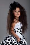 Asiatisk liten flicka i härlig klänning Arkivbilder