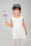 Asiatisk liten kinesisk flicka i prinsessan Costume royaltyfria foton