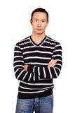 Asiatisk man i randig Pullover Arkivbild