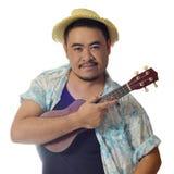 Asiatisk man med ukulelet Fotografering för Bildbyråer