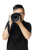 Asiatisk man som använder kameran Royaltyfria Bilder