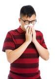Asiatisk man som har en sjuk influensa Arkivfoto