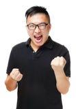 Asiatisk man som känner sig upphetsad Royaltyfri Foto