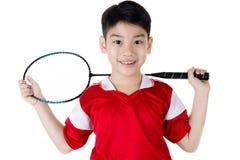 Asiatisk pojke i badmintonhandling Royaltyfria Foton