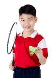 Asiatisk pojke i badmintonhandling Royaltyfria Bilder