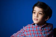 Asiatisk pojke i kontrollskjorta Royaltyfria Foton