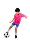 Asiatisk pojke med fotbollbollen Royaltyfria Foton