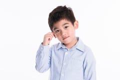 Asiatisk pojke - olika bilder av isolering Arkivfoton