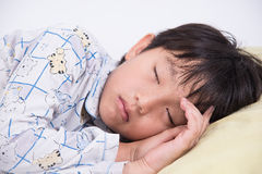 Asiatisk pojkesömn Arkivbilder