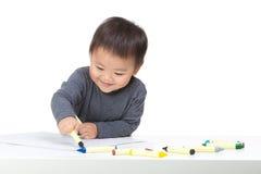 Asiatisk pojketeckning med färgpennan Royaltyfria Bilder