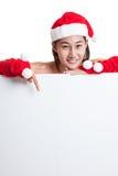 Asiatisk punkt för julSanta Claus flicka ner som förbigår tecknet Arkivfoton