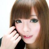 Asiatisk söt leendeflicka Fotografering för Bildbyråer