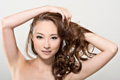 Asiatisk skönhetframsida och hår Royaltyfri Fotografi
