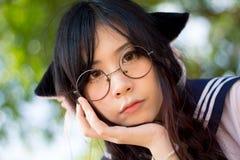 Asiatisk skolaflicka med att charma ögon royaltyfria bilder
