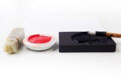Asiatisk traditionell borstepenna och färgpulver för kalligrafi Royaltyfri Foto