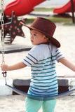 Asiatisk unge i lekplats Arkivbild