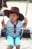 Asiatisk unge i lekplats Royaltyfri Foto