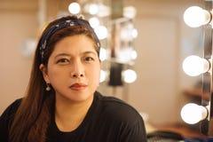Asiatisk vuxen kvinna i loge Royaltyfria Foton
