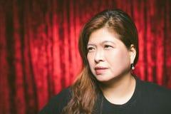 Asiatisk vuxen kvinna i loge Royaltyfri Foto