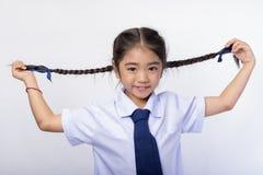 Asiatiska barn som ljust ler på kameran Arkivfoto