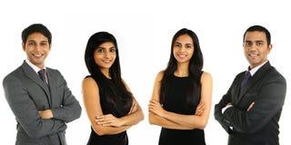 Asiatiska indiska affärsmän och affärskvinna i en grupp Arkivbild