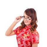 Asiatiska kinesiska flickakläder eller handtagexponeringsglas i traditionell kines arkivfoton