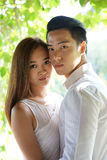 Asiatiska par som är förälskade i highkey Royaltyfria Foton