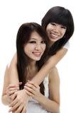 Asiatiska systrar Arkivbild