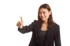 Asiatiska tummar för affärskvinna up och ler Royaltyfri Foto