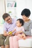 Asiatiska tusen dollarföräldrar Arkivbild