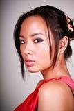 asiatiskt barn för closeupmodellstående Fotografering för Bildbyråer