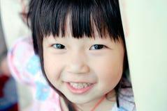 asiatiskt barnleende Royaltyfri Foto