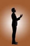 Asiatiskt be för affärsman royaltyfri foto