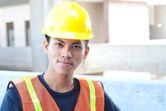 asiatiskt byggnadsarbetarebarn royaltyfri fotografi