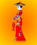 asiatiskt dockatyg gjorde röda kvinnor Arkivbilder