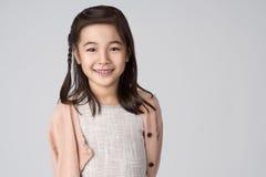 Asiatiskt flickastudioskott Fotografering för Bildbyråer