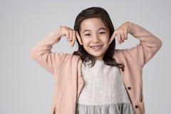 Asiatiskt flickastudioskott Arkivbild