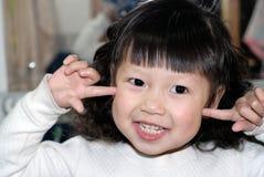 asiatiskt gulligt flickaleende Royaltyfria Foton